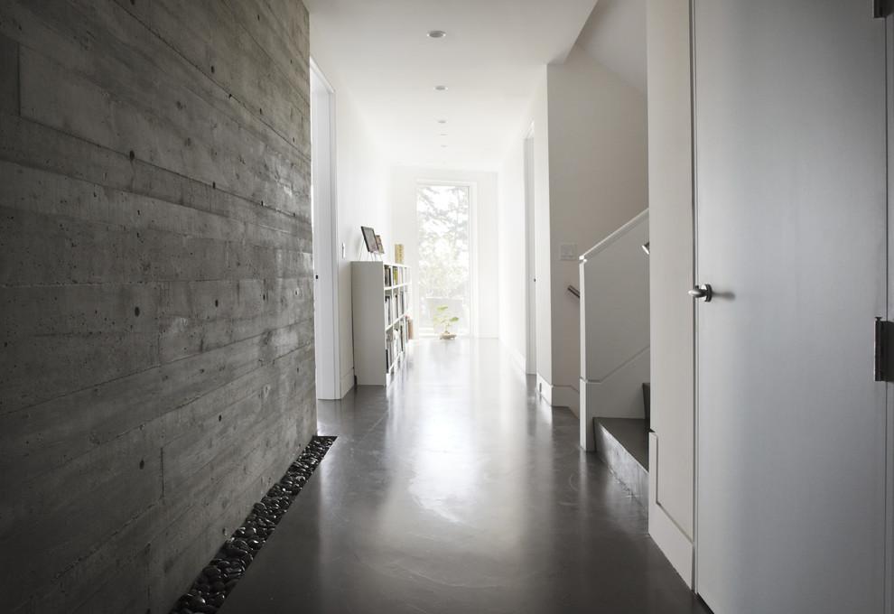 Example of a minimalist concrete floor and gray floor hallway design in Vancouver