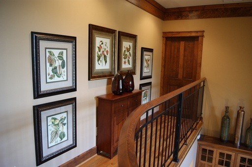 Inspiration for a mid-sized transitional medium tone wood floor hallway remodel in Atlanta with beige walls