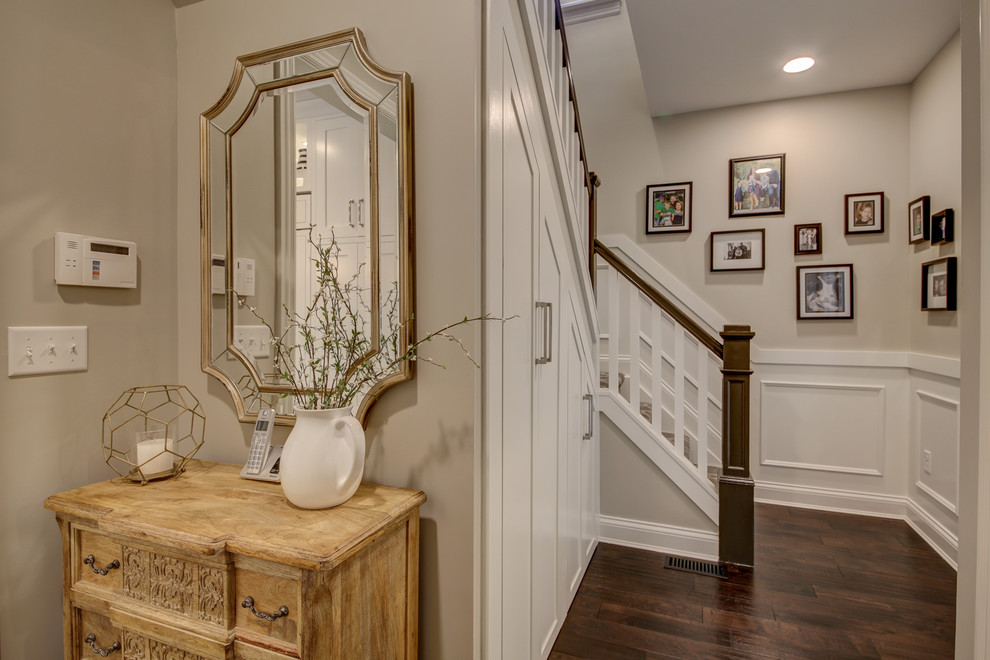 Example of a mid-sized transitional dark wood floor and brown floor hallway design in Dallas with gray walls