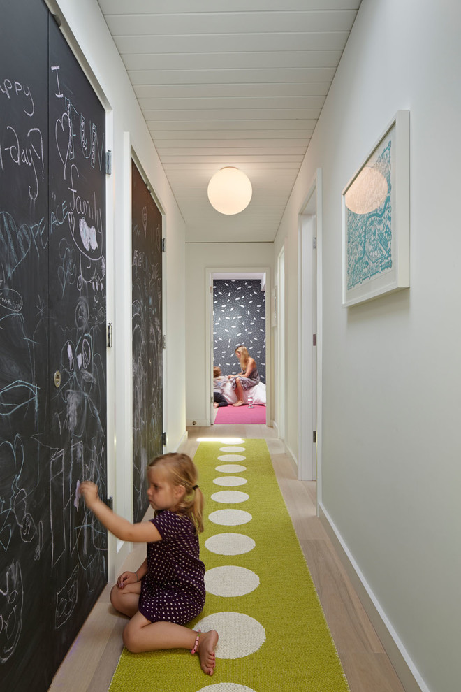 Midcentury modern hallway photo in San Francisco with white walls