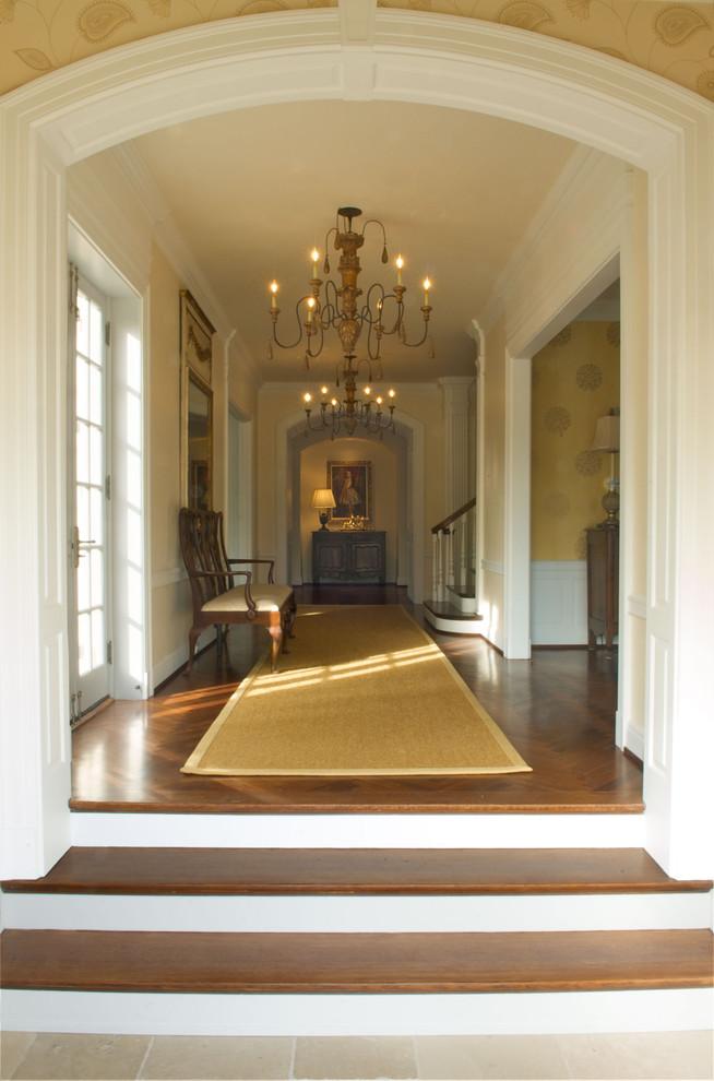Inspiration for a timeless dark wood floor hallway remodel in Cincinnati with beige walls