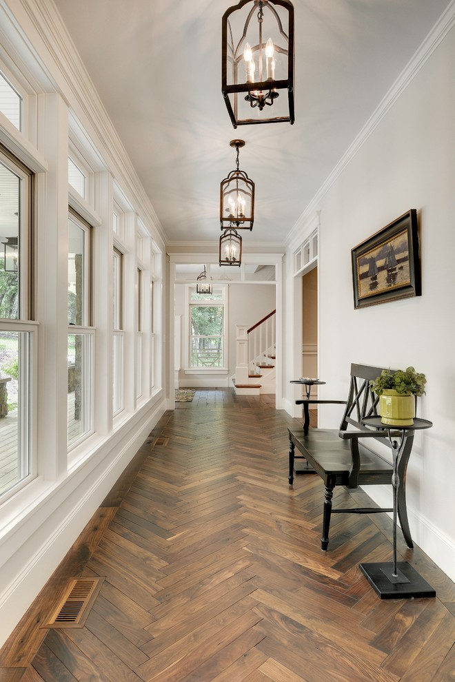 Example of a transitional dark wood floor and brown floor hallway design in Minneapolis with white walls