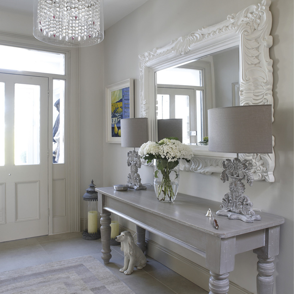 Inspiration for a shabby-chic style hallway remodel in Dublin with gray walls