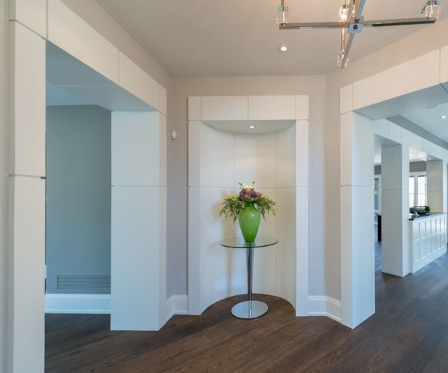 Large transitional medium tone wood floor hallway photo in Toronto with gray walls