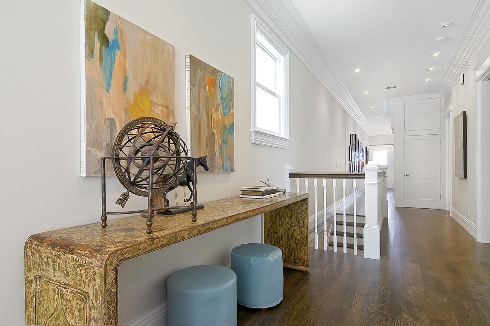 Hallway - traditional brown floor hallway idea in San Francisco with white walls