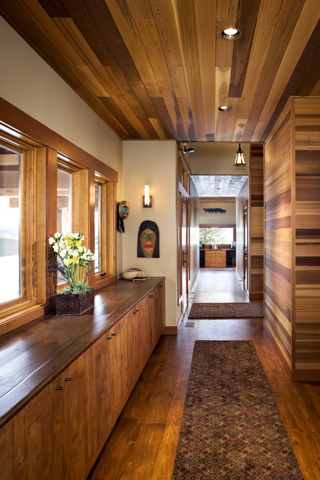 Inspiration for a mid-sized contemporary medium tone wood floor and brown floor hallway remodel in Boise with beige walls