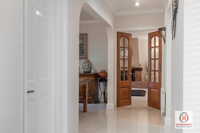 Hallway leading into double doors into living room - Modern - Hall ...