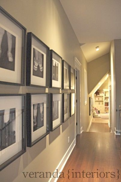 Many family pictures down narrow hallway tips suggestions for Hallway wall decor