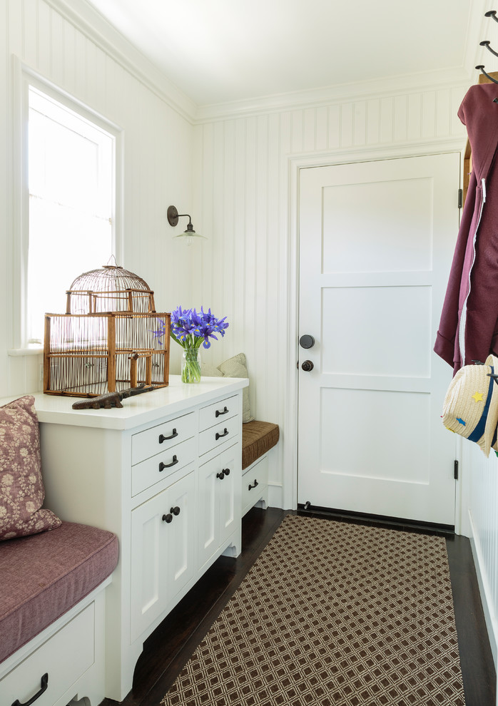 Inspiration for a small timeless dark wood floor and brown floor hallway remodel in Los Angeles with white walls