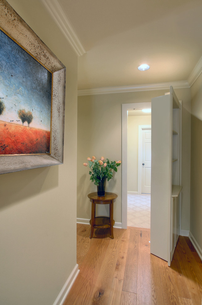 Inspiration for a timeless medium tone wood floor hallway remodel in Seattle with gray walls