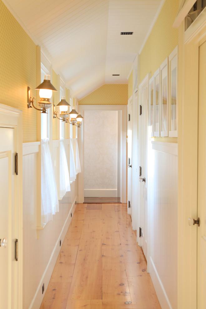 Mid-sized elegant light wood floor and beige floor hallway photo in Boston with yellow walls