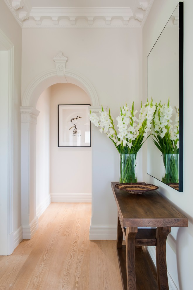 Hallway - contemporary light wood floor hallway idea in Sydney with beige walls