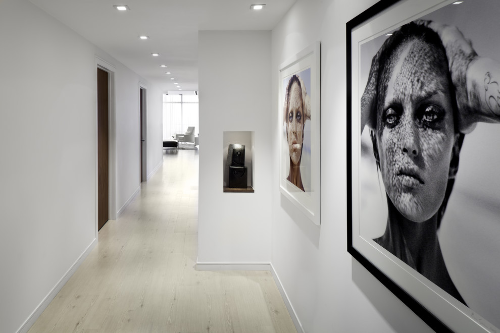 Example of a trendy beige floor hallway design in Miami with white walls