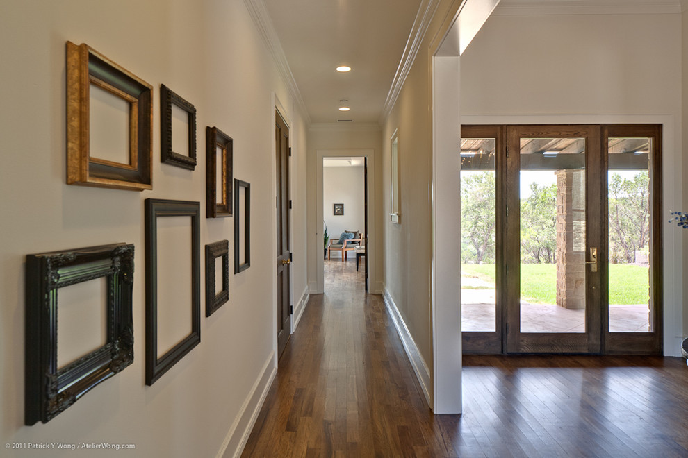 Inspiration for a transitional hallway remodel in Austin with white walls