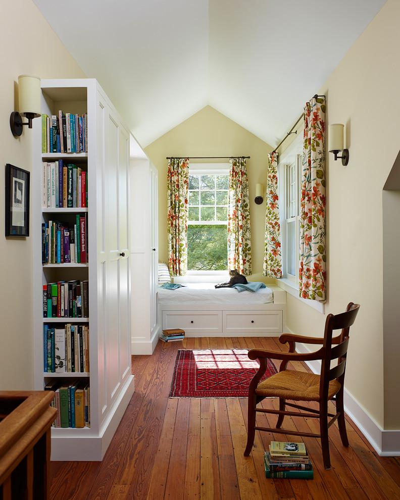 Country medium tone wood floor hallway photo in Philadelphia with beige walls