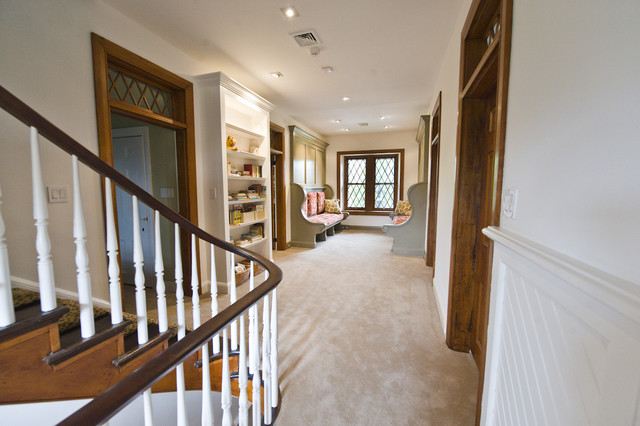 Inglenook bench benches turn hallway into children's reading room. traditional-hall