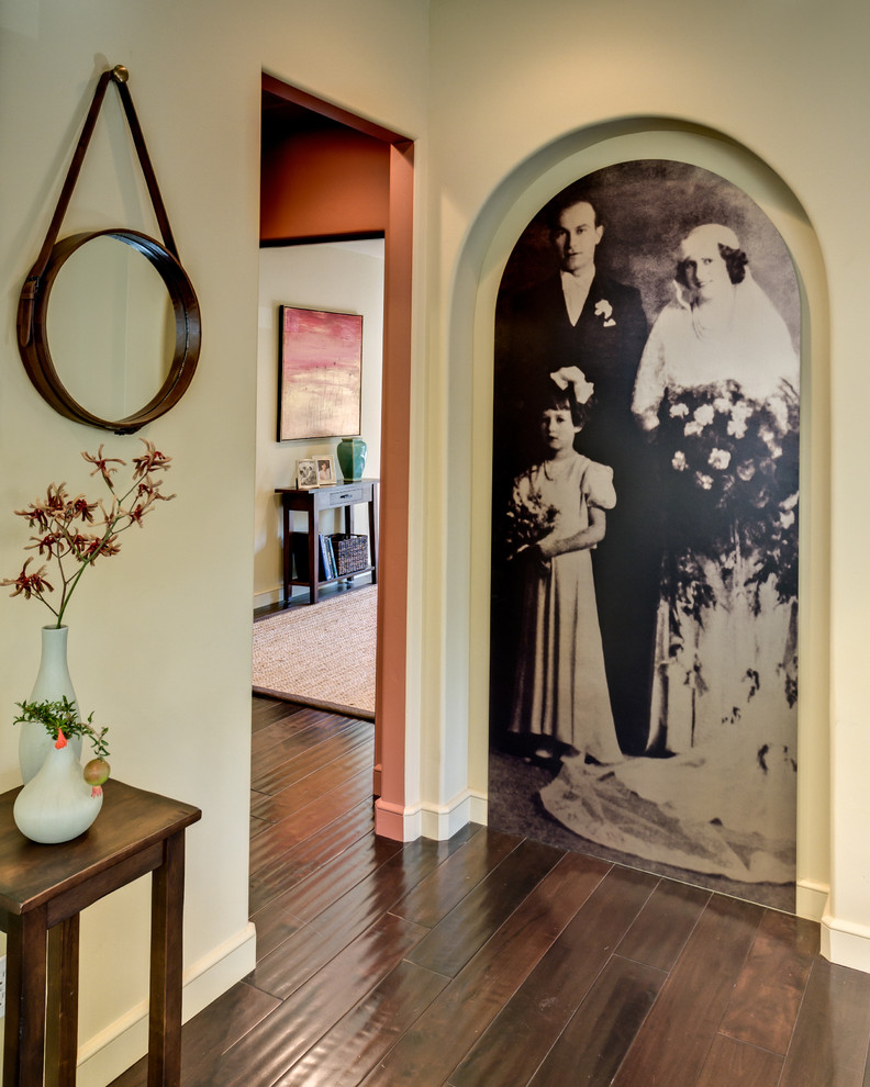 Example of a mid-sized tuscan dark wood floor and brown floor hallway design in San Francisco with beige walls