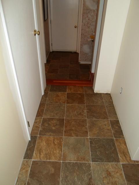 Kitchen sheet vinyl tile look tarkett traditional hall for Kitchen sheet vinyl flooring