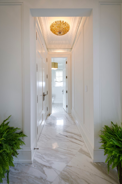 Inspiration for a modern marble floor hallway remodel in Toronto with white walls