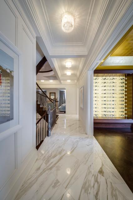 Hallway - modern marble floor hallway idea in Toronto with white walls