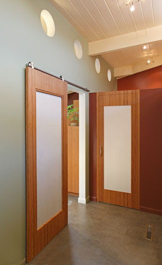 Klopf Architecture - Front Hall with custom sliding bamboo doors midcentury-hall