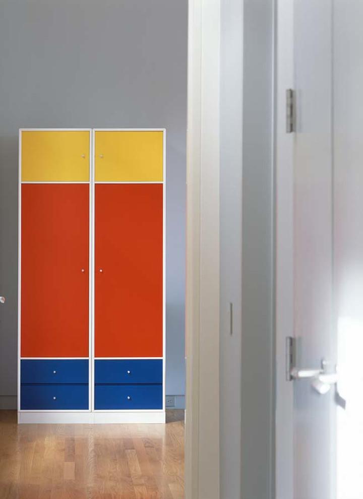 Example of a trendy medium tone wood floor hallway design in Austin with gray walls