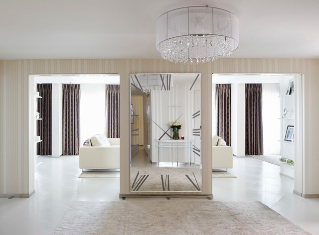 Hallway - contemporary hallway idea in London with beige walls