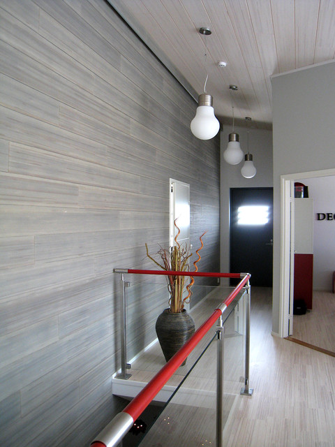 Example of a trendy hallway design in Other with gray walls