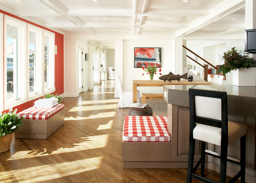 Example of a large beach style medium tone wood floor hallway design in Boston with red walls