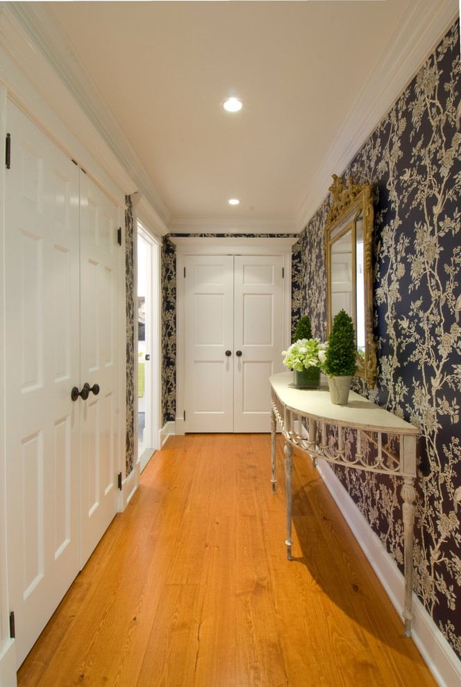 Hallway - mid-sized traditional medium tone wood floor and brown floor hallway idea in Other with white walls