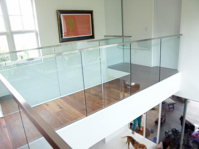 Miami beach home glass railings installation modern for Modern glass railing