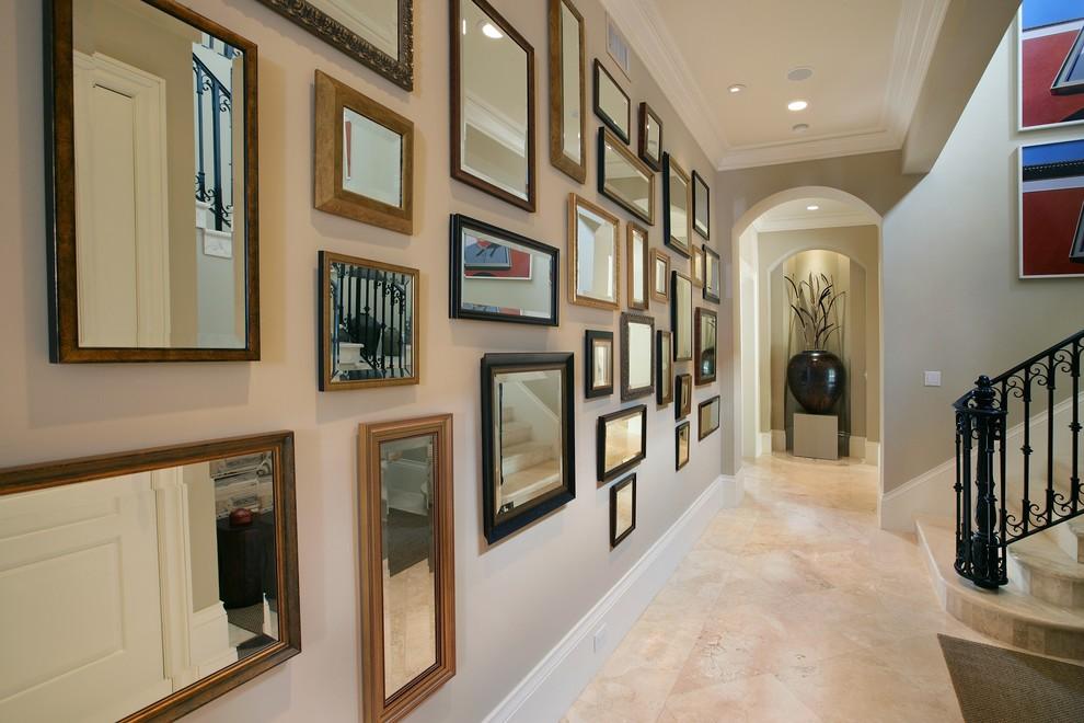 Inspiration for an eclectic travertine floor and beige floor hallway remodel in Miami with beige walls