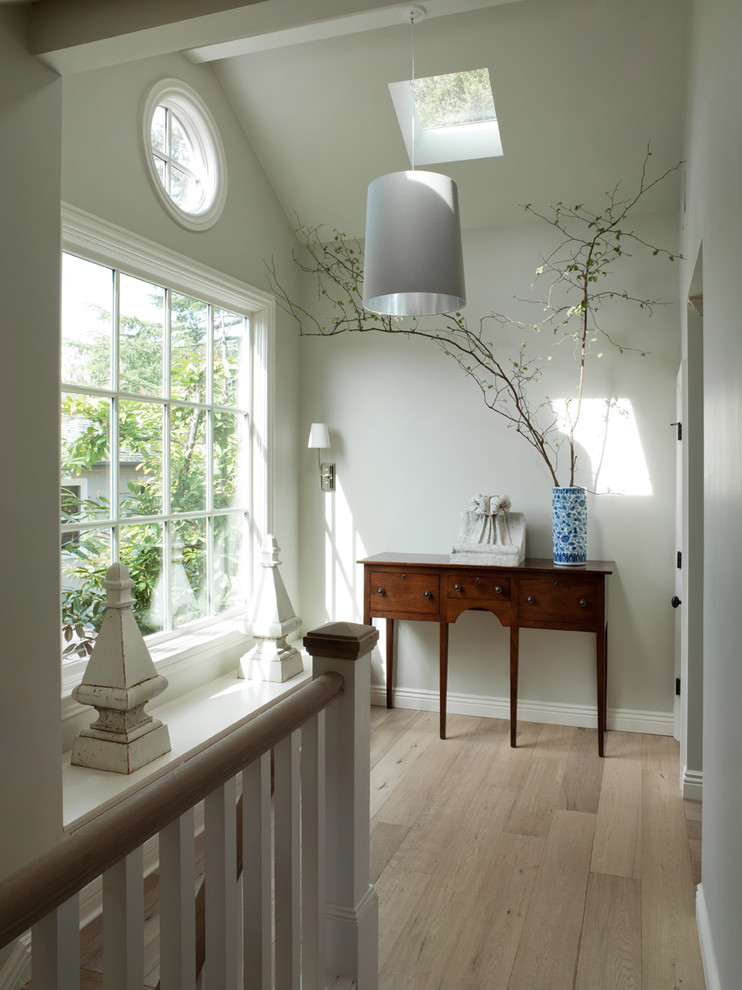 Example of a classic light wood floor and beige floor hallway design in San Francisco with white walls