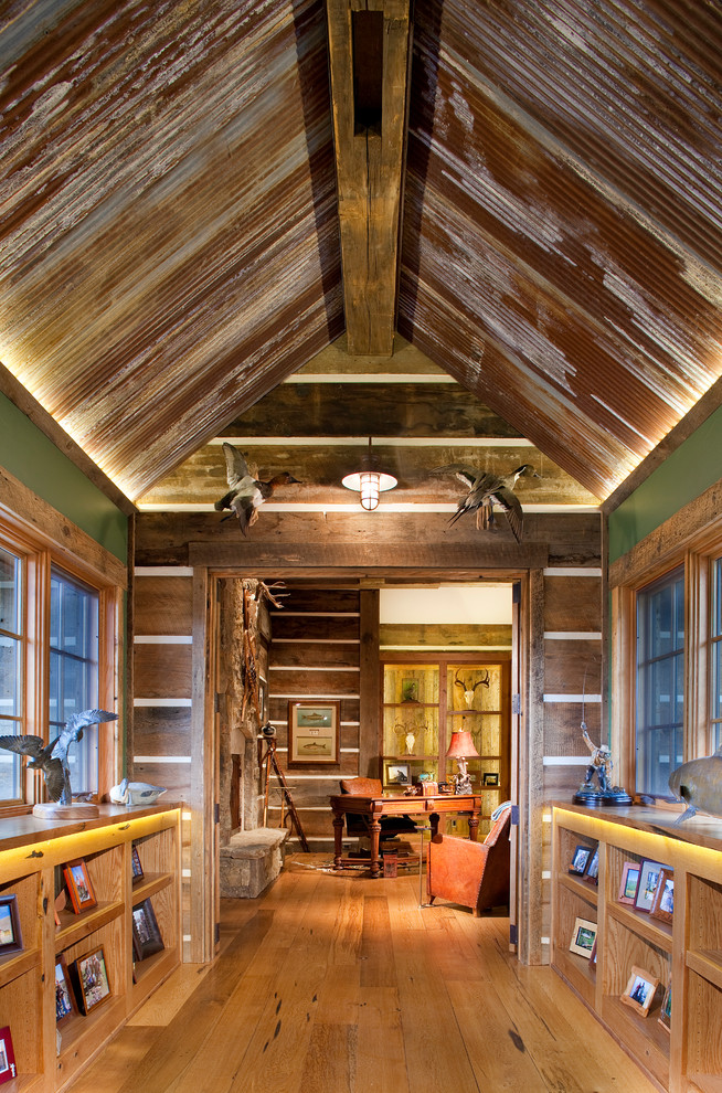 Hallway - rustic medium tone wood floor hallway idea in Denver with green walls