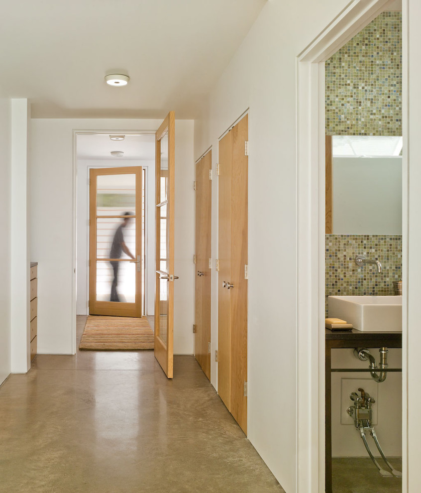 Mid-sized cottage concrete floor and beige floor hallway photo in Burlington with white walls