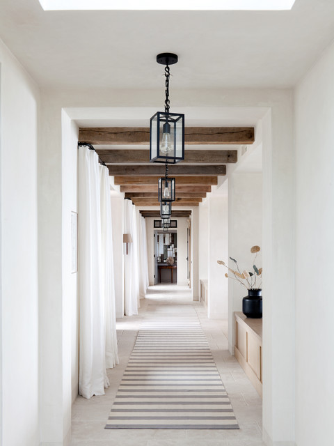 Example of a large hallway design in Orange County with white walls