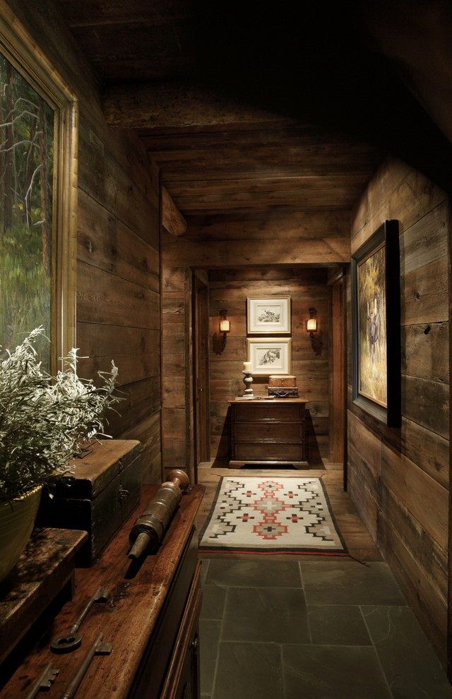 Example of a mountain style hallway design in Other with brown walls