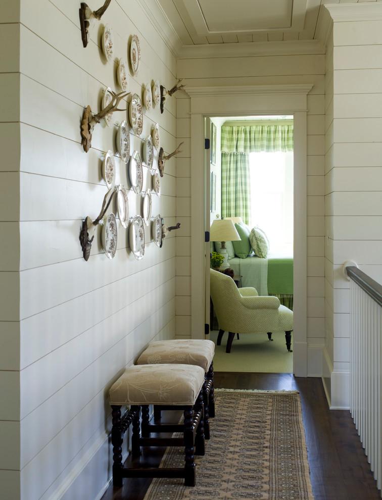 Large elegant dark wood floor hallway photo in Raleigh with white walls