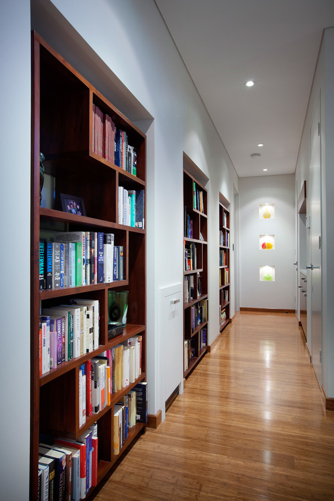 Trendy medium tone wood floor hallway photo in Perth with white walls