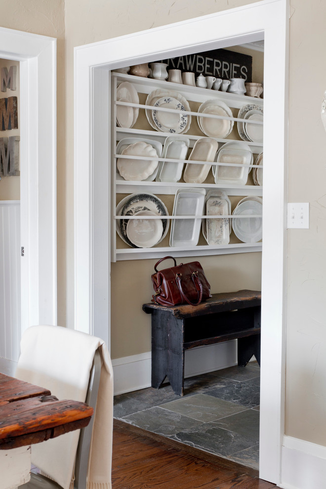 Inspiration for a shabby-chic style hallway remodel in New York with beige walls