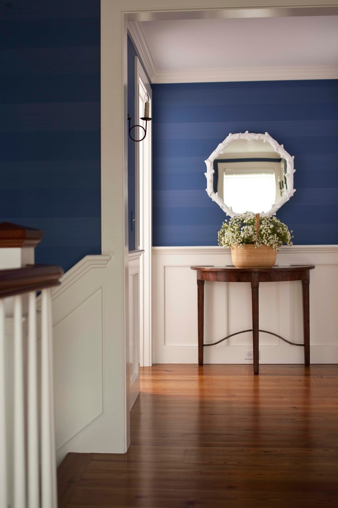 Inspiration for a mid-sized timeless dark wood floor hallway remodel in Boston with blue walls