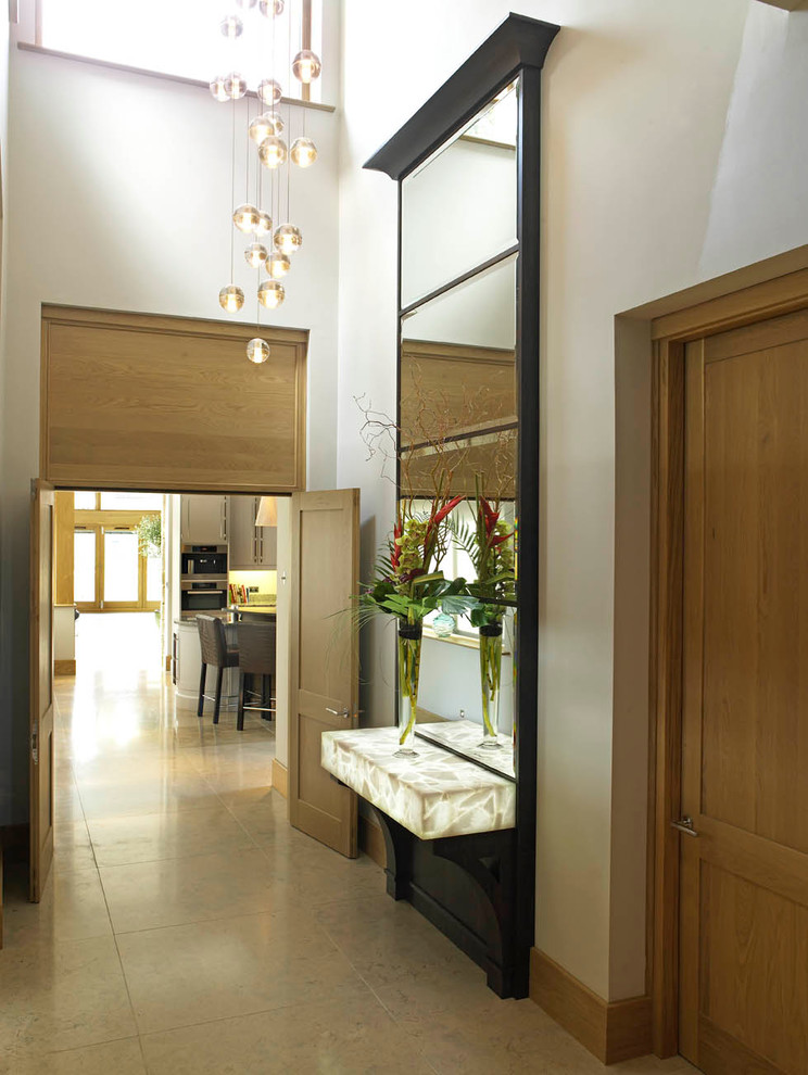 Hallway - large contemporary hallway idea in Other with white walls