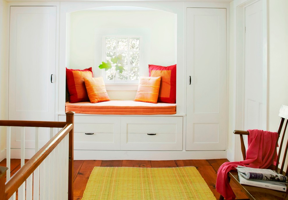 Inspiration for a farmhouse dark wood floor hallway remodel in New York with white walls