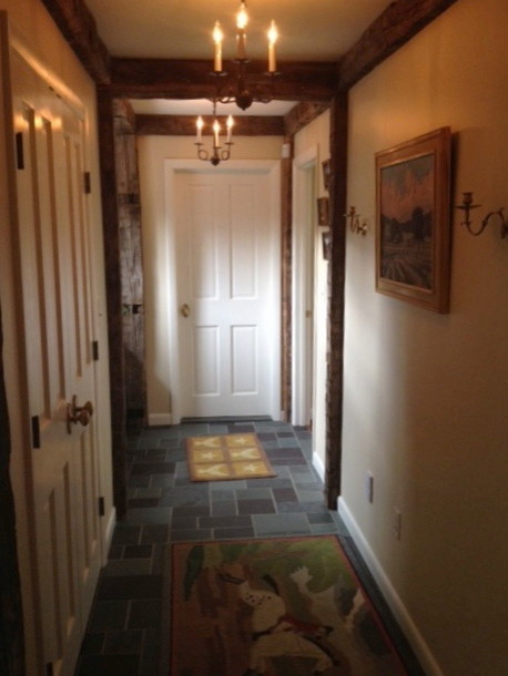 New Hallway With Reclaimed Beams And Slate Floor