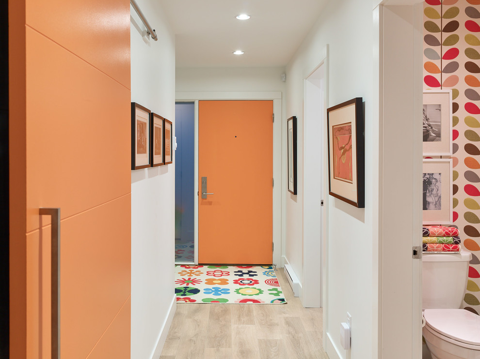 Example of a 1960s light wood floor hallway design in Vancouver with white walls