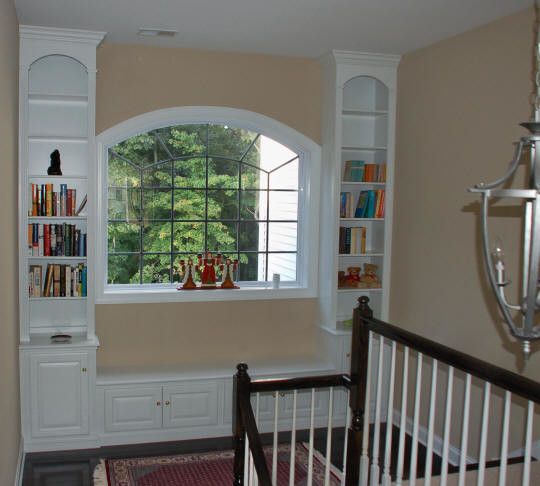 Painted Window Unit at stair landing traditional-hall