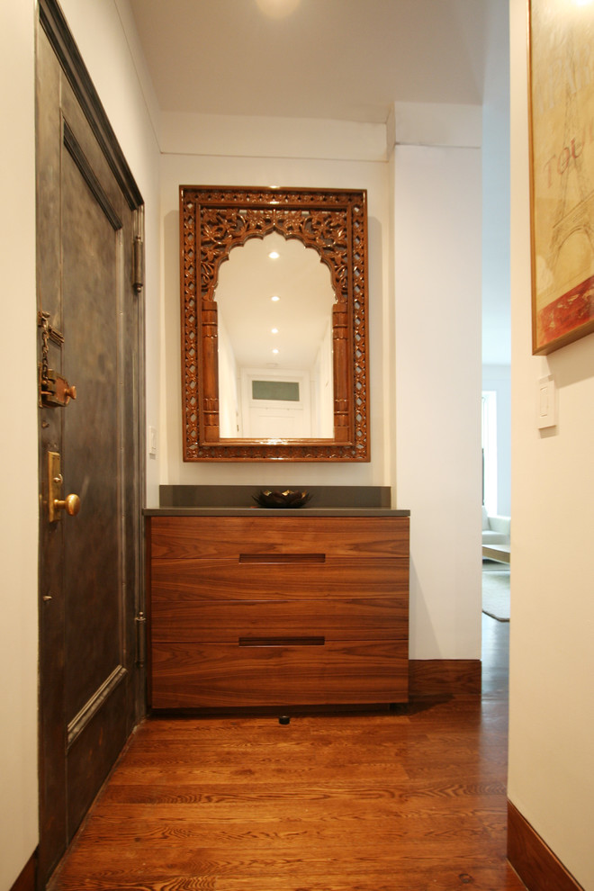 Inspiration for a contemporary medium tone wood floor hallway remodel in New York with white walls