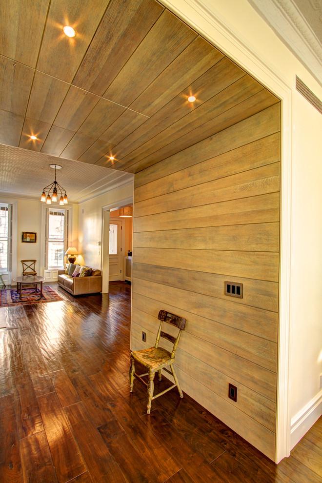 Hallway - traditional dark wood floor and brown floor hallway idea in New York with beige walls