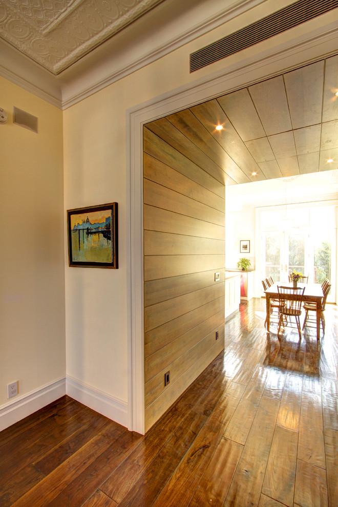 Example of a classic dark wood floor and brown floor hallway design in New York with beige walls