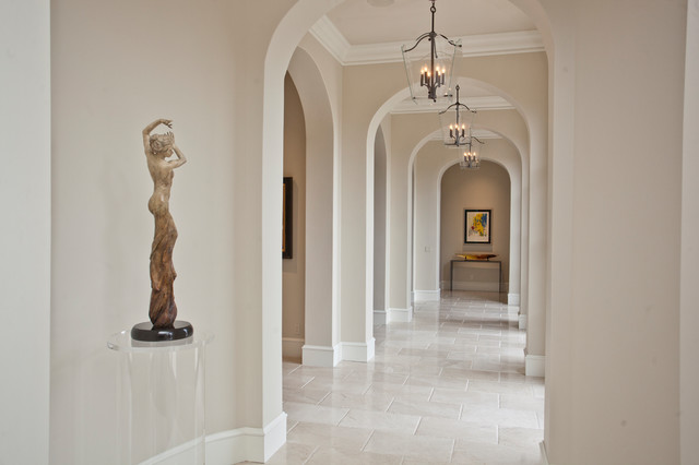 Inspiration for a large transitional travertine floor and beige floor hallway remodel in Other with beige walls